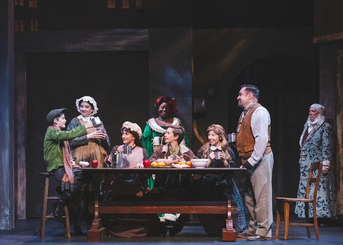 Cratchit Family at table.
